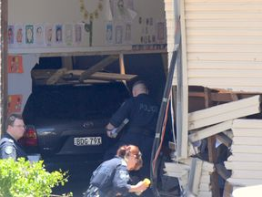 Pupils' drawings are visible on the walls of the classroom where the car crashed