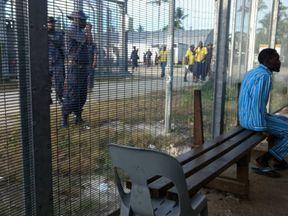 Police enter the Manus Island detention centre on Manus Island, Papua New Guinea, November 23, 2017