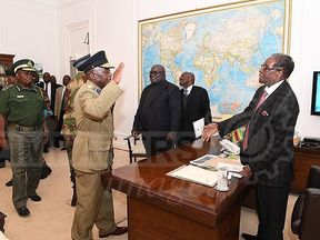 Robert Mugabe meets generals from the Zimbabwe Defence Forces at State House. Pic: Herald newspaper