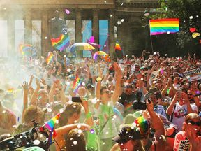MELBOURNE, AUSTRALIA - NOVEMBER 15: People in the crowd celebrate as the result is announced during the Official Melbourne Postal Survey Result Announcement at the State Library of Victoria on November 15, 2017 in Melbourne, Australia. Australians have voted for marriage laws to be changed to allow same-sex marriage, with the Yes vote defeating No. Despite the Yes victory, the outcome of Australian Marriage Law Postal Survey is not binding, and the process to change current laws will move to the