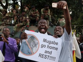 Zimbabweans celebrate Robert Mugabe's resignation in the streets of Harare