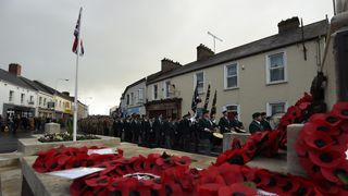 Soldiers and veterans parade during events to remember the 12 victims of the IRA's 1987 Remembrance Sunday bomb attack in Enniskillen, Co Fermanagh.