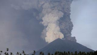 A view of Mount Agung volcano erupting from Culik village in Karangasem