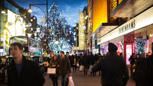 People carry shopping bags along Oxford Street on December 24, 2016 in London, England. Christmas shoppers hunt for last minute presents in central London on Christmas Eve