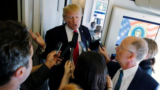 President Trump answers questions on board Air Force One