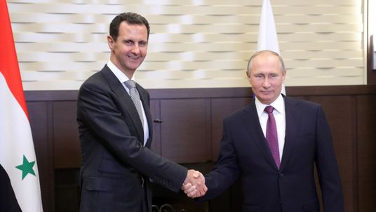 Russian President Vladimir Putin shakes hands with his Syrian counterpart Bashar al-Assad during a meeting in Sochi