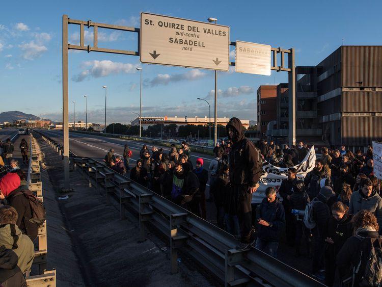 Demonstrators block a highway