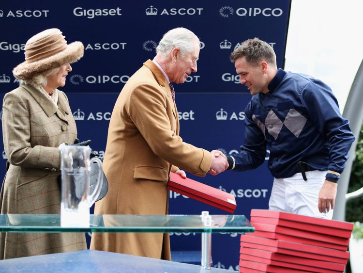 Prince Charles shakes hands with Michael Owen after he rode to second place
