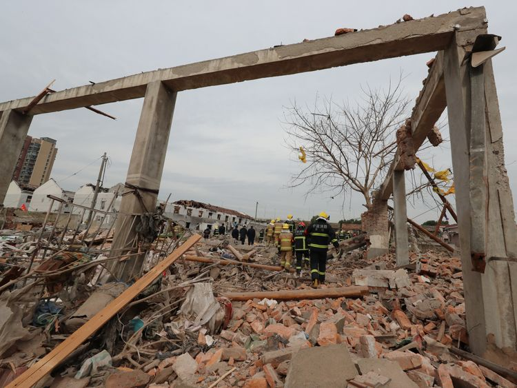 Rescue workers are seen at the site of an explosion in Ningbo, China's eastern Zhejiang province on November 26, 2017