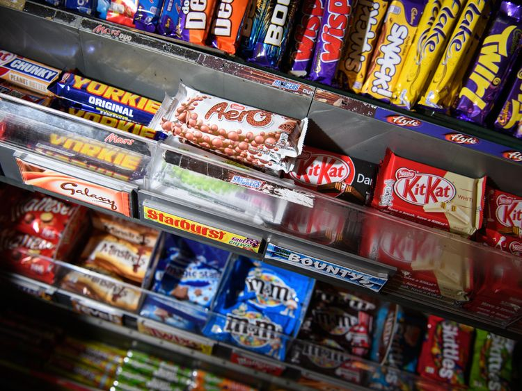 A selection of confectionery and chocolates are seen on a newsagent shelf on December 8, 2016 in London, England. The Committee on Advertising Practice has announced a ban on online advertisements for food and drinks with a high fat, salt or sugar content