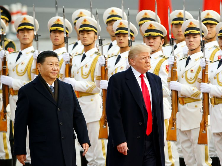 U.S. President Donald Trump takes part in a welcoming ceremony with China's President Xi Jinping in Beijing, China, November 9, 2017