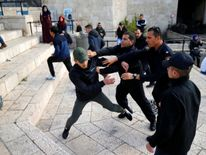 Israeli policemen scuffle with a Palestinian man near Damascus Gate in Jerusalem's Old City