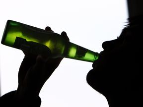 A teenager drinking alcohol. File picture