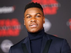 London-born John Boyega only just made it to the premiere after getting stuck in a snowstorm