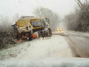 A gritter that slid off the road near Trefnant in Denbighshire, Wales