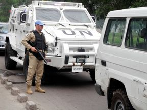 A UN peacekeeper patrols the streets during violent protests in the Democratic Republic of Congo's capital Kinshasa