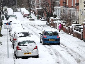 Motorists brave the snow in Worcester, as heavy snowfall across parts of the UK is causing widespread disruption, closing roads and grounding flights at an airport.
