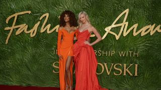 British model Jordan Dunn and American model Karlie Kloss pose on the red carpet upon arrival to attend the British Fashion Awards in London