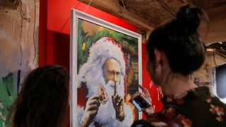 "Paintings depicting Russian president Vladimir Putin dressed as Father Frost, Russian equivalent of Santa Claus, at the ""SUPERPUTIN"" exhibition"