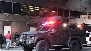 An armoured police truck occupies the street outside of the New York Port Authority in New York City