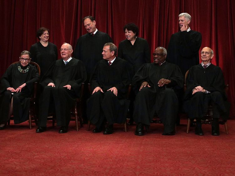 The nine US Supreme Court justices. Bottom row (left to right) Ruth Bader Ginsburg,  Anthony M Kennedy,  Chief Justice John Roberts, Clarence Thomas, Stephen Breyer. Back row (left to right) Elena Kagan, Samuel Alito, Sonia Sotomayor and Neil Gorsuch