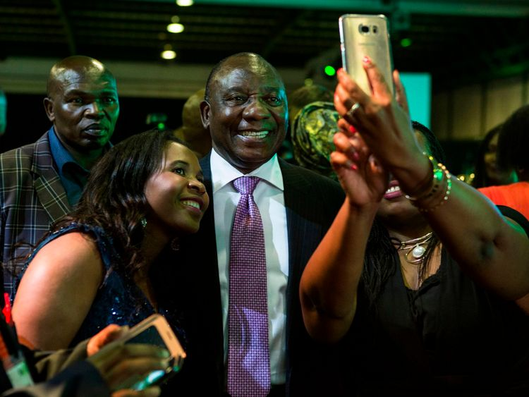 Cyril Ramaphosa (centre) could end up being South Africa's next president