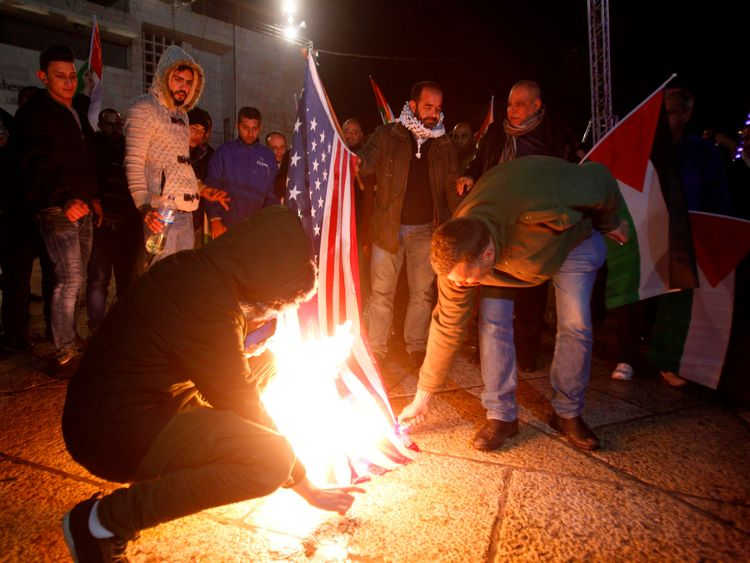 Palestinian demonstrators burned the US flag in Bethlehem's Manger Square
