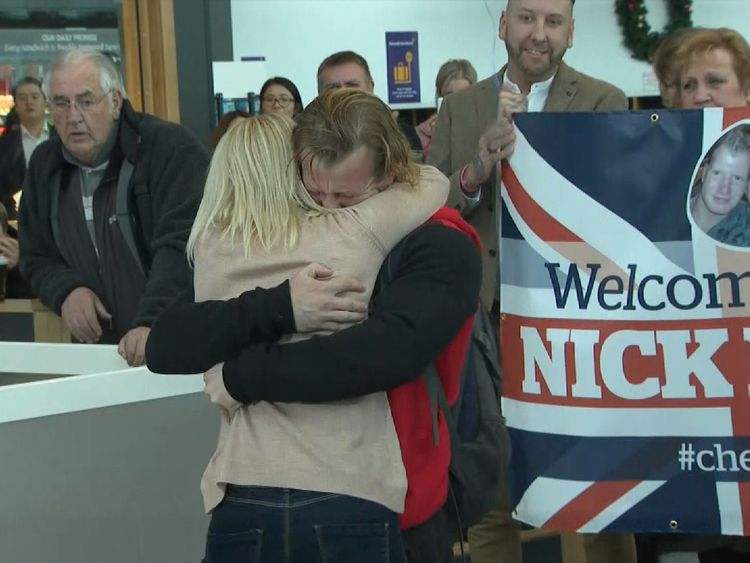 Nick Dunn at Newcastle airport hugging his wife