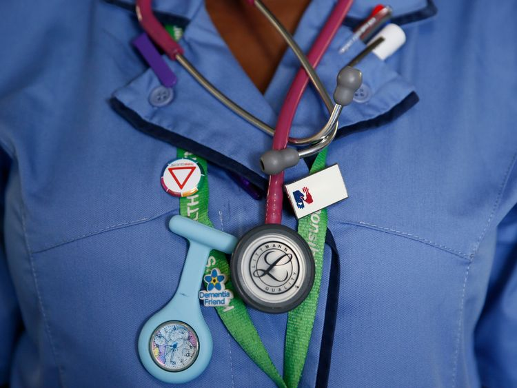 A nurse wears a watch and stethoscope at St Thomas' Hospital in central London January 28, 2015