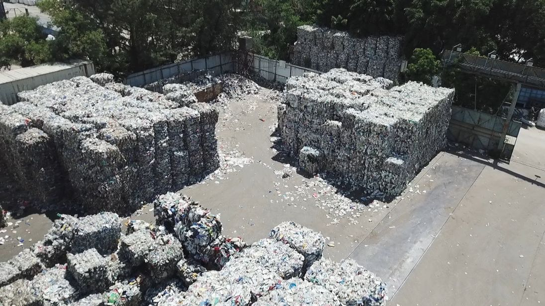 Plastics recycling that was exported from the UK has been left on a yard in Hong Kong, now destined for landfill