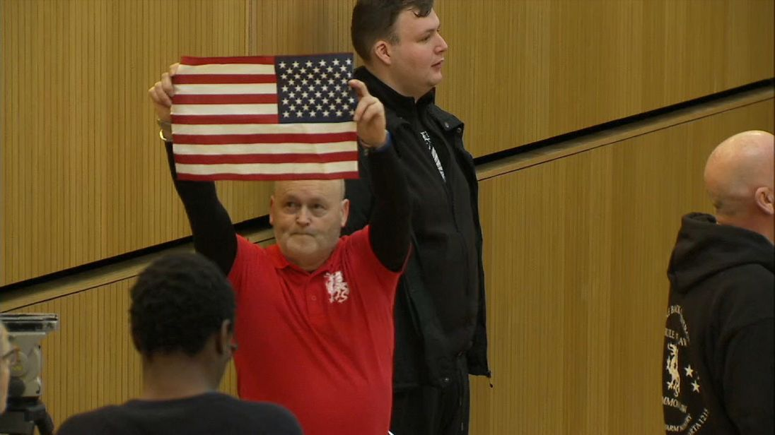 One of the demonstrators held an American flag