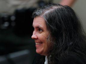 Louise Turpin smiles during the hearing