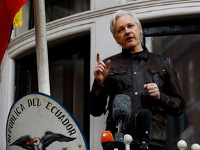 WikiLeaks founder Julian Assange is seen on the balcony of the Ecuadorian Embassy in London, Britain, May 19, 2017. REUTERS/Peter Nicholls/File Photo