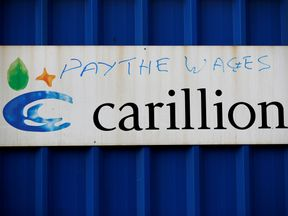 Defaced branding is seen outside Carillion's Royal Liverpool Hospital site