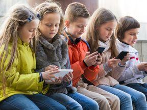 Children on mobile phones