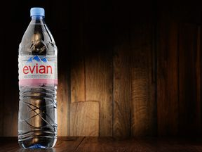 A plastic Evian water bottle