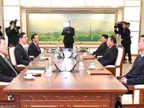 Head of North Korean delegation Jon Jong Su talks with his South Korean counterpart Chun Hae-sung during their meeting at the truce village of Panmunjom in the demilitarised zone separating the two Koreas,. Pic: Yonhap/Reuters