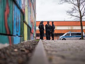 LUNEN, GERMANY - JANUARY 23: Police guards stand in front of the Kaethe Kollwitz comprehensive school following the stabbing of a pupil on January 23, 2018 in Luenen, Germany. A 15-year-old pupil reportedly stabbed a 14-year-old with a knife and the victim has died from his wounds. So far authorities have released no further information about who the pupils are and what motive or circumstances might have led to the stabbing. (Photo by Lukas Schulze/Getty Images)