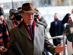 Nigel Farage arrives for a meeting with European Union's chief Brexit negotiator Michel Barnier in Brussels