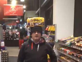 Sinn Fein Mp Barry McElduff with a loaf of Kingsmill on his head