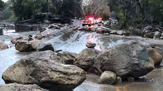 Boulders block a road after a mudslide in Montecito, California