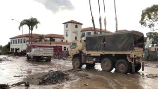 Military vehicles arrive to assist evacuation operations at an area damaged by mudslides in Montecito, California