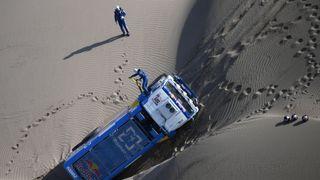 Eduard Nikolaev and copilot Evgeny Yakovlev of Russia work on their Kamaz truck during the Peru-Bolivia-Argentina Dakar rally