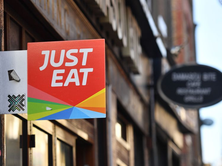 A sign for Just Eat, a food delivery service can be seen above a restaurant in London on December 18, 2017...Just Eat has been welcomed on December 18, 2017 into UK's FTSE 100 index of the country's largest publicly listed companies.  / AFP PHOTO / BEN STANSALL        (Photo credit should read BEN STANSALL/AFP/Getty Images)