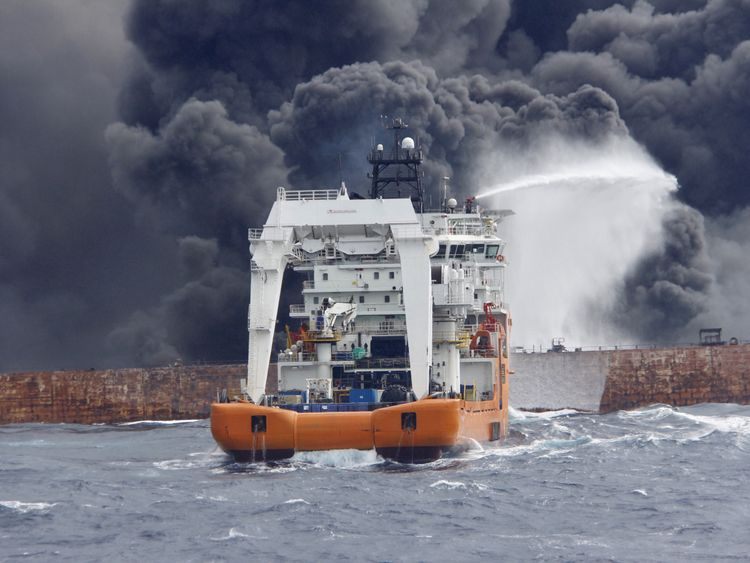 A rescue ship works to extinguish the fire on the burning Iranian oil tanker Sanchi