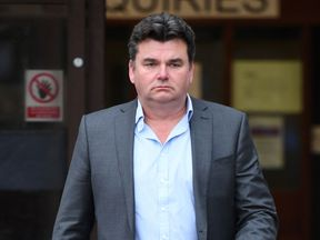 Former BHS owner Dominic Chappell leaves Barkingside Magistrates' Court, where he has been ordered to pay £87,170 after failing to provide information about the firm's pension schemes to investigators when it collapsed with the loss of thousands of jobs.