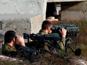 Israeli soldiers have taken up positions in the Golan Heights near the Syrian border