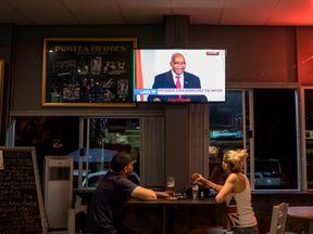 People watch Jacob Zuma address the nation as he leaves power