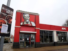 A closed sign outside a KFC restaurant near Ashford, Kent