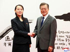 South Korean President Moon Jae-in shakes hands with Kim Yo Jong, the sister of North Korea's leader Kim Jong Un